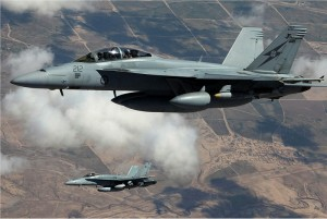 An RAAF F/A-18F Super Hornet F/A-18A Hornet in the skies over Iraq. Photo: Department of Defence